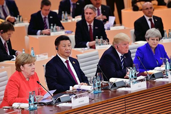 7월 7일 G20 정상회의 당시 모습. 왼쪽부터 개최국인 독일의 메르켈 총리, 시진핑 중국 국가주석, 도널드 트럼프 미국 대통령, 테레사 메이 영국 총리이다. | Thomas Lohnes/Getty Images