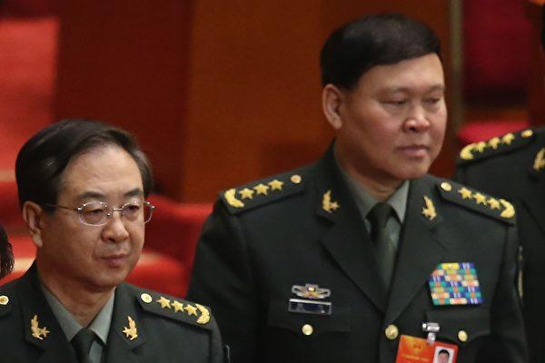 장양(張陽·66) 정치공작부 주임(오른쪽)이 자살했다고 관영 신화통신이 28일 보도했다.   Feng Li/Getty Images