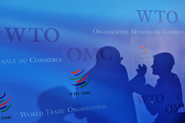 2001년 중국이 세계무역기구(WTO)에 가입하자 국제 무역시장에 '윈-윈(win-win)' 효과를 가져다 줄 것이라는 예측이 지배적이었다. 그러나 이 예측은 18년 후인 현재 벌이지고 있는 중미 간 무역 충돌에서 볼 수 있듯 크게 빗나간 것으로 판명됐다. | FABRICE COFFRINI/AFP/Getty Images