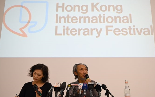 Dissident Chinese author Ma Jian (R) speaks during a press conference at the new Tai Kwun arts centre in Hong Kong on Nov. 10, 2018, which hosts the Hong Kong International Literary Festival and had originally cancelled his talks under pressure from Beijing. | ANTHONY WALLACE/AFP/Getty Images