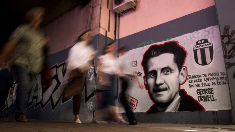 "People walk past a mural painted by an artist of the Grobarski Trash Romantizam (GTR) group, depicting British novelist George Orwell with the reading ""Freedom is the right to tell people what they do not want to hear"", in Belgrade on May 8, 2018. - They are ""Gravediggers' Trash Romantism"" and cover the walls of Belgrade with their love for Partizan, one of two main Serbian clubs, far from the image of ultranationalism and violent Balkan fans. In Belgrade, many willingly offer their theory what will make a supporter a soldier of the army of ""Grobari"" (Gravediggers) of Partizan or ""Cigani"" (Gypsies) of Red Star, two giants of Yugoslav and Serbian football, founded at the end of World War II. (Photo by OLIVER BUNIC / AFP) / RESTRICTED TO EDITORIAL USE - MANDATORY MENTION OF THE ARTIST UPON PUBLICATION - TO ILLUSTRATE THE EVENT AS SPECIFIED IN THE CAPTION        (Photo credit should read OLIVER BUNIC/AFP/Getty Images)"