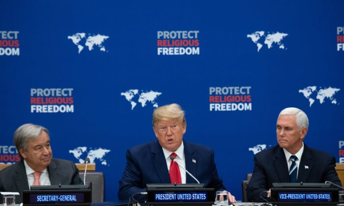 US President Donald Trump (C) speaks alongside US Vice President Mike Pence (R) and UN Secretary General Antonio Guterres (L) at a United Nations event on Religious Freedom at UN Headquarters in New York, September 23, 2019, on the sidelines of the UN General Assembly. (Photo by SAUL LOEB / AFP)        (Photo credit should read SAUL LOEB/AFP/Getty Images)