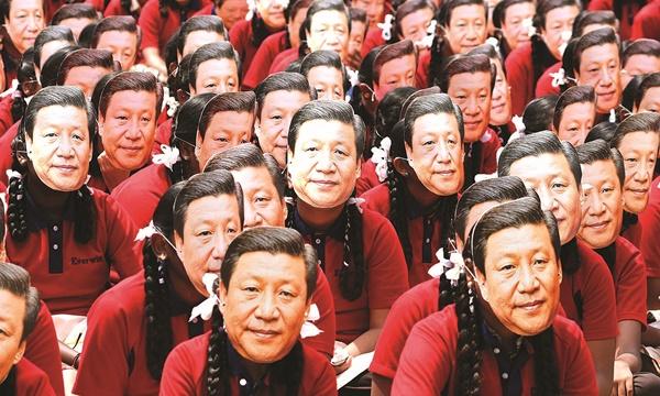 시진핑 주석의 얼굴 사진으로 만든 가면을 쓴 인도 학생들. | AFP=연합뉴스
