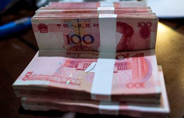 중국 경제 성장률 하락, 통화 팽창 정책, 무역갈등 심화 등은 위안화 평가절하를 재촉했다. | JOHANNES EISELE/AFP/Getty Images