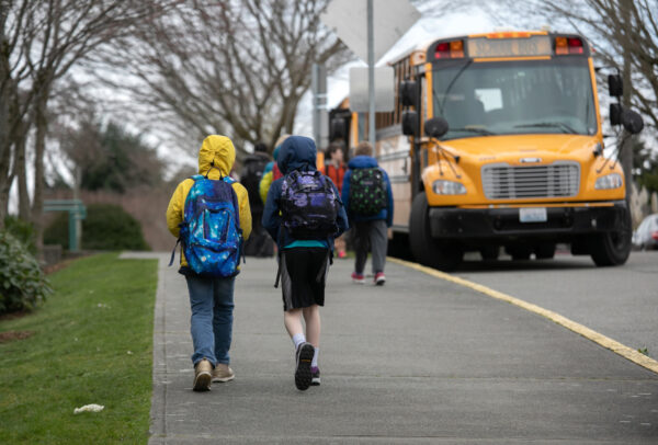 SEATTLE, WASHINGTON - MARCH 11: Students leave the Thurgood Marshal Elementary school after the Seattle Public School system was abruptly closed due to coronavirus fears on March 11, 2020 in Seattle, Washington. Schools will be closed for a minimum of two weeks. The system is the largest public school district in Washington State. (Photo by John Moore/Getty Images)