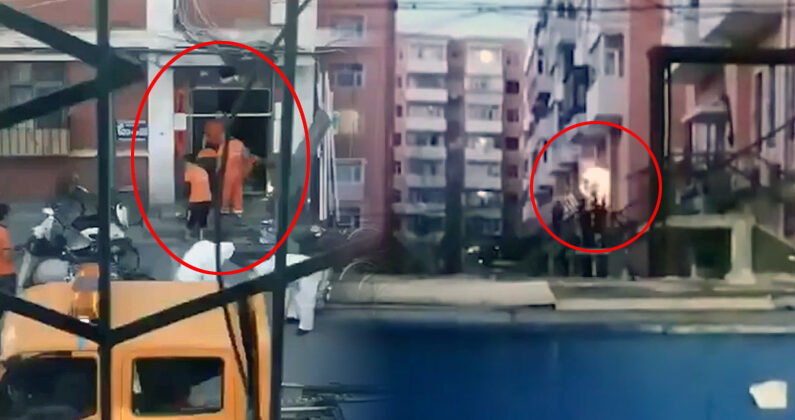 폐쇄되는 베이징 하이뎬구 융딩루 5가 아파트단지의 한 출입구. 작업요원들이 철판으로 막고 용접해 완전히 봉쇄하고 있다. | 영상 캡처