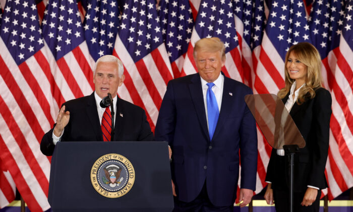 WASHINGTON, DC - NOVEMBER 04: Vice President Mike Pence speaks as U.S. President Donald Trump and first lady Melania Trump watch on election night in the East Room of the White House in the early morning hours of November 04, 2020 in Washington, DC. Trump spoke shortly after 2am with the presidential race against Democratic presidential nominee Joe Biden still too close to call. (Photo by Chip Somodevilla/Getty Images)