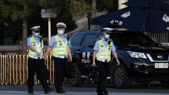 베이징 천안문 광장 근처의 교통 경찰. | GREG BAKER/AFP via Getty Images
