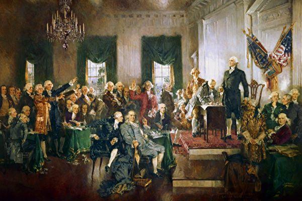 1787년 필라델피아에서 미국 헌법에 서명하는 모습을 담은 하워드 챈들러 크리스티의 유화. 단상에 선 사람은 회의 진행자인 조지 워싱턴 장군.   퍼블릭 도메인