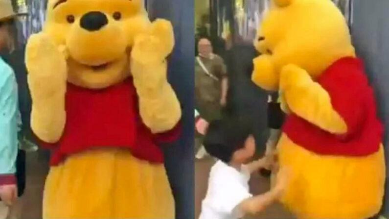 상하이 디즈니랜드를 찾은 아이가 곰돌이 푸를 때리는 모습 | 웨이보