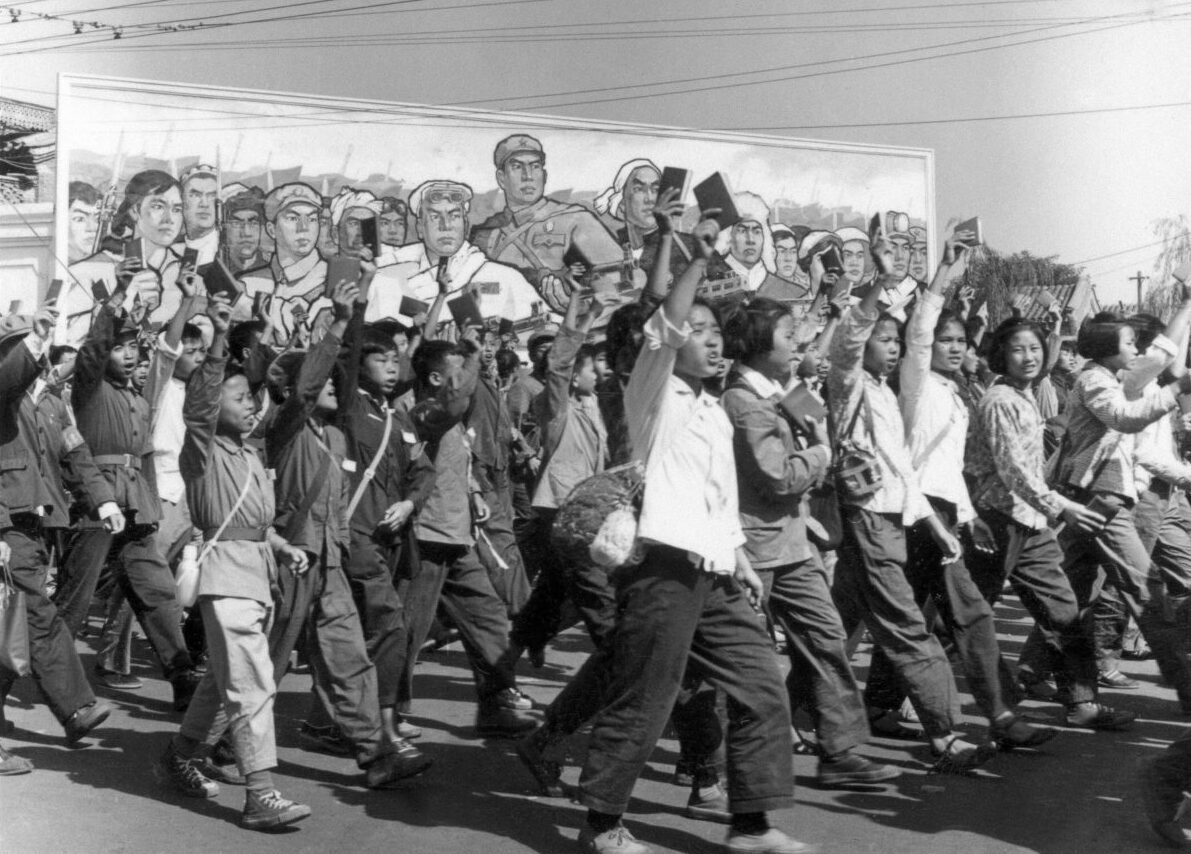 Chinese Red Guards, high school and university students, waving copies of Chairman Mao Zedong