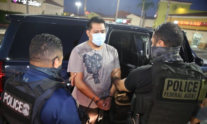 ICE's Enforcement and Removal Operations Officers arrest criminal aliens with criminal records who are subject to removal from the United States, in Los Angeles, Calif., on Oct. 1, 2020. (Michael Johnson/U.S. Immigration and Customs Enforcement)